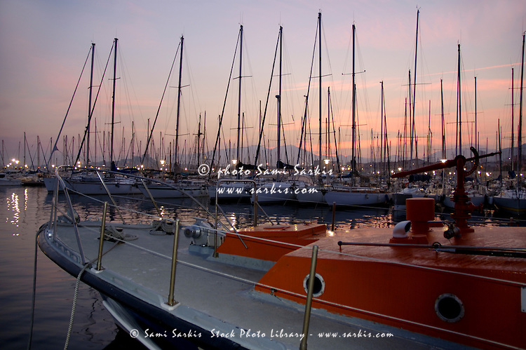 Sunset over boats moored in a marina, Marseille, France.