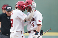 Arkansas catcher Casey Opitz (12) embraces infielder Cullen Smith (14) following a score, Monday, June 7, 2021 in the NCAA Fayetteville Regional at Baum-Walker Stadium in Fayetteville. Check out nwaonline.com/210608Daily/ for today's photo gallery. <br /> (NWA Democrat-Gazette/Charlie Kaijo)