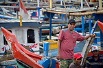 13 February 2019,Pelabuhan Ratu,Sukabumi Regency, West Java, Indonesia. Local fisherman Yosep on his boat at the crowded fishing port at Pelabuhan Ratu. His brother has been jailed in Australia on charges of people smuggling from the area. Now  local fisherman say that people smugglers have not been active in the area for a long time in the wake of the Australian Government's concern that boats will once again start trafficking people to Australia with the new Medical legislation that has been passed. Picture by Graham Crouch/The Australian