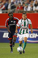 Santos Laguna midfielder Juan Pablo Rodriguez (58) is chased by New England Revolution forward Kheli Dube (11). The New England Revolution defeated Santos Laguna 1-0 during a Group B match of the 2008 North American SuperLiga at Gillette Stadium in Foxborough, Massachusetts, on July 13, 2008.