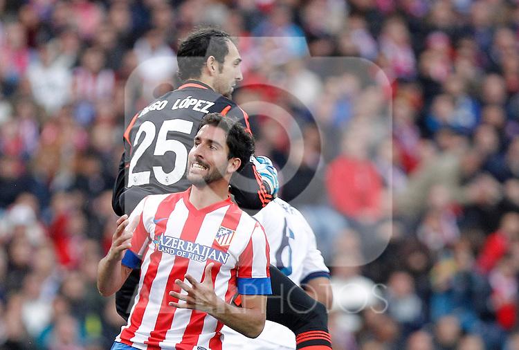 Atletico de Madrid's Raul Garcia against Real Madrid's Diego Lopez during La Liga match. April 27, 2013. (ALTERPHOTOS/Alvaro Hernandez)