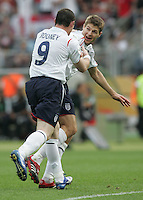 JUNE 15, 2006: Nuremberg, Germany: English midfielder (4) celebrates his goal with teammate (9) Wayne Rooney. England defeated Trinidad & Tobago, 2-0, in their FIFA World Cup Group B match at Franken-Stadion.