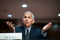 Anthony Fauci, director of the National Institute of Allergy and Infectious Diseases, speaks during a Senate Health, Education, Labor and Pensions Committee hearing in Washington, D.C., U.S., on Tuesday, June 30, 2020. Top federal health officials are expected to discuss efforts to get back to work and school during the coronavirus pandemic. <br /> Credit: Al Drago /CNP/AdMedia