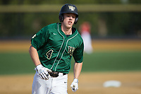 D.J. Poteet (4) of the Wake Forest Demon Deacons rounds the bases after hitting a solo home run in the bottom of the first inning against the Louisville Cardinals at David F. Couch Ballpark on March 17, 2018 in  Winston-Salem, North Carolina.  The Cardinals defeated the Demon Deacons 11-6.  (Brian Westerholt/Four Seam Images)