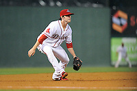 Third baseman Jimmy Rider (5) of the Greenville Drive dives for a ball hit down the line in a game against the Rome Braves on Thursday, July 31, 2014, at Fluor Field at the West End in Greenville, South Carolina. Rome won the rain-shortened game, 4-1. (Tom Priddy/Four Seam Images)