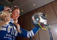 Feb 6, 2020; Pomona, CA, USA; NHRA top fuel driver Leah Pruett uses her chrome helmet as a mirror to check her hair prior to posing for a portrait during NHRA Media Day at the Pomona Fairplex. Mandatory Credit: Mark J. Rebilas-USA TODAY Sports