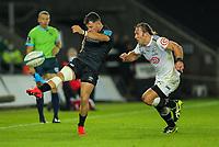 8th October 2021;  Swansea.com Stadium, Swansea, Wales; United Rugby Championship, Ospreys versus Sharks; Luke Morgan of Ospreys kicks forward while under pressure from Werner Kok of Cell C Sharks