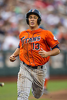 Cal State Fullerton Titans shortstop Timmy Richards (13) scores the game's first run during the third inning of the NCAA College baseball World Series against the Vanderbilt Commodores on June 14, 2015 at TD Ameritrade Park in Omaha, Nebraska. The Titans were leading 3-0 in the bottom of the sixth inning when the game was suspended by rain. (Andrew Woolley/Four Seam Images)