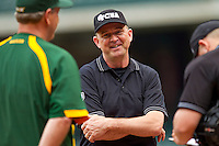 Umpire Doug Williams meets with the head coaches at home plate prior to the game between the Baylor Bears and the Houston Cougars at Minute Maid Park on March 4, 2011 in Houston, Texas.  Photo by Brian Westerholt / Four Seam Images