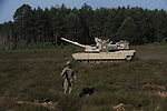 "American soldiers with Delta Company, 2nd Battalion, 7th Infantry Regiment, 1st Armored Brigade Combat Team, 3rd Infantry Division in M1A2 Abrams tanks during a tank training exercise practicing infiltration at the Drawsko Pomorskie Training Area in Poland on June 12, 2015.    NATO is engaged in a multilateral training exercise ""Saber Strike,"" the first time Poland has hosted such war games, involving the militaries of Canada, Denmark, Germany, Poland, and the United States."