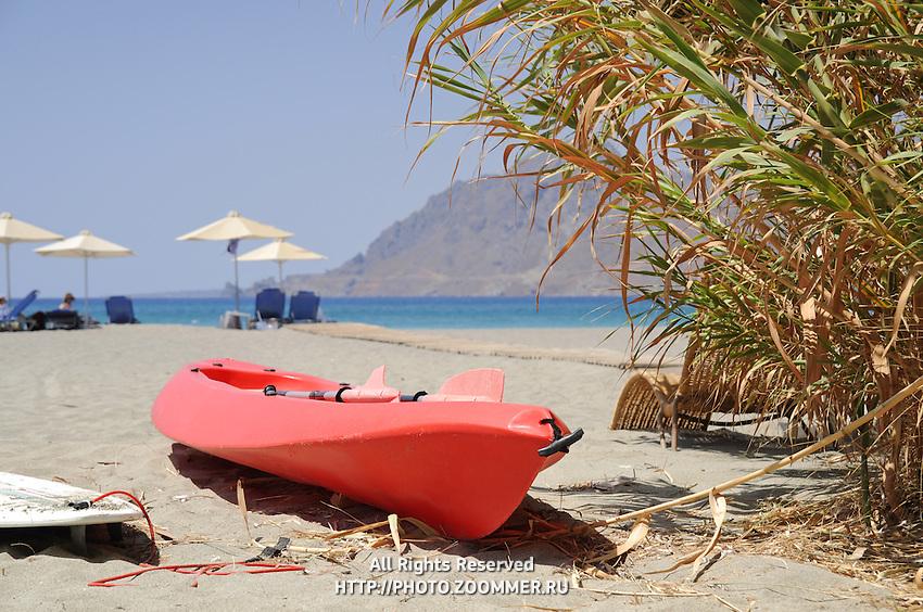 Red kayak in Plakias beach on Crete