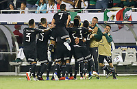 CHICAGO, ILLINOIS - JULY 07: Mexico scores and celebrates during the 2019 CONCACAF Gold Cup Final match between the United States and Mexico at Soldier Field on July 07, 2019 in Chicago, Illinois.