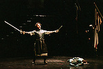 2001 - MACBETH - Macduff (Andrew Richards) celebrates his victory over Macbeth (Richard Paul Fink) in Opera Pacific's production of Macbeth.