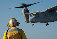 130423-N-DR144-171 Pacific Ocean (April 23, 2013)-  An Aviation Boatswain's Mate (Handling) watches as an MV-22 Osprey assigned to Marine Medium Tiltrotor Squadron (VMM) 161 launches from the flight deck of the Amphibious Transport Dock Ship USS Anchorage (LPD 23). Anchorage is currently en route to its namesake city of Anchorage, Alaska for its commissioning ceremony May 4. (U.S. Navy photo by Mass Communication Specialist 1st Class James R. Evans / RELEASED)