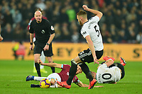 Mark Noble of West Ham United tackles Calum Chambers of Fulham during West Ham United vs Fulham, Premier League Football at The London Stadium on 22nd February 2019