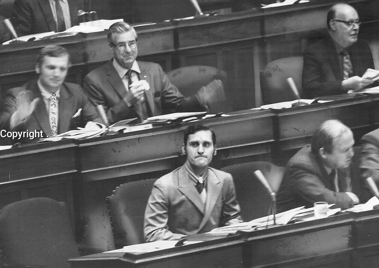 1970 FILE PHOTO -<br /> <br /> On his first day on the job as the leader of the New Democratic Party, Stephen Lewis is welcomed to his seat at Queen's Park by members pounding their hand son their desks in applause yesterday. Sitting to right is NDP's James Renwick (Riverdale). Lewis later attacked Ontario's proposed new labor legislation.