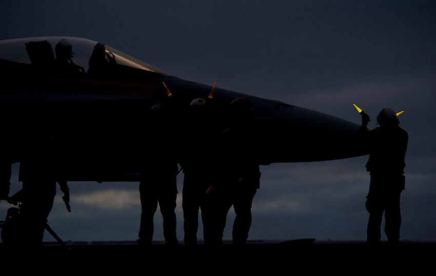 101215-N-7981E-603 PACIFIC OCEAN (Dec. 15, 2010)- An F/A-18C Hornet is readied for launch after sunset on the flight deck of USS Carl Vinson (CVN 70). Carl Vinson and Carrier Air Wing (CVW) 17 are currently on a three-week composite training unit exercise (COMPTUEX) followed by a western Pacific deployment. (U.S. Navy photo by Mass Communication Specialist 2nd Class James R. Evans / RELEASED)