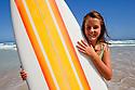 Girl holding retro surfboard