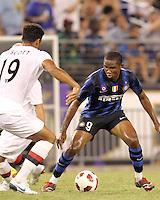 Samuel Eto'o #9 of Inter Milan cuts away from Jolson Lescott of Manchester City during an international friendly match on July 31 2010 at M&T Bank Stadium in Baltimore, Maryland. Milan won 3-0.