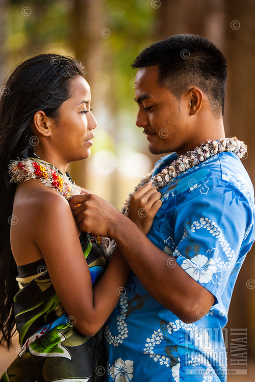 A young local couple talk of their engagement at Kailua Beach Park, Windward O'ahu.