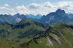 Austria, Vorarlberg, Schoppernau: view from Diedamskopf mountain into Austrian Alps with Widderstein mountain right and Biberkopf and Lechtaler Wetterspitze background middle