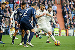Real Madrid's Karim Benzema and Malaga CF's Weligton Robson during La Liga match between Real Madrid and Malaga CF at Santiago Bernabeu Stadium in Madrid, Spain. January 21, 2017. (ALTERPHOTOS/BorjaB.Hojas)
