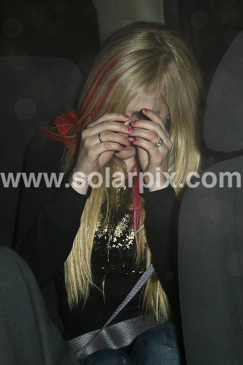**ALL ROUND PICTURES FROM SOLARPIX.COM**.**WORLDWIDE SYNDICATION RIGHTS**.**NO PUBLICATION IN AUSTRALIA, DENMARK, GERMANY, NEW ZEALAND, RUSSIA, UK OR USA**.Avril Lavigne and husband Deryck Whibley seen leaving Koi Restaurant in West Hollywood, California, USA. 23rd August 2008..This pic: Avril Lavigne..JOB REF: 7110 LAP/VIP HD       DATE: 23_08_2008.**MUST CREDIT SOLARPIX.COM OR DOUBLE FEE WILL BE CHARGED* *UNDER NO CIRCUMSTANCES IS THIS IMAGE TO BE REPRODUCED FOR ANY ONLINE EDITION WITHOUT PRIOR PERMISSION*