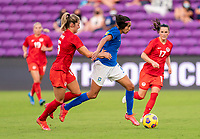 ORLANDO, FL - FEBRUARY 24: Janine Beckie #16 of Canada fights for the ball with Andressa #7 of Brazil during a game between Brazil and Canada at Exploria Stadium on February 24, 2021 in Orlando, Florida.