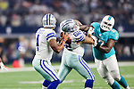 Dallas Cowboys quarterback Dak Prescott (4), Dallas Cowboys offensive guard Jared Smith (62) and Miami Dolphins defensive tackle Jordan Phillips (97) in action during the pre-season game between the Miami Dolphins and the Dallas Cowboys at the AT & T stadium in Arlington, Texas.