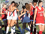 CHESHIRE CT. - 09 November 2020-110920SV04-#12 Lauren Houle of Cheshire High, left, celebrates with teammates after scoring against Branford High during the semifinals of SCC field hockey tournament in Cheshire Monday.<br /> Steven Valenti Republican-American