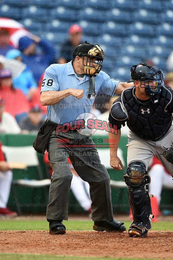Umpire Dan Iassogna strike three call behind catcher Brian McCann (34) during a Spring Training game between the New York Yankees and Philadelphia Phillies on March 27, 2015 at Bright House Field in Clearwater, Florida.  New York defeated Philadelphia 10-0.  (Mike Janes/Four Seam Images)