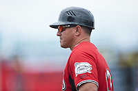 Carolina Mudcats coach Liu Rodriguez (13) coaches first base during the game against the Kannapolis Cannon Ballers at Atrium Health Ballpark on July 18, 2021 in Kannapolis, North Carolina. (Brian Westerholt/Four Seam Images)