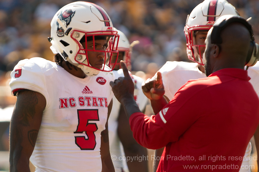 North Carolina State defensive back Johnathan Alston gets instruction from a coach. The North Carolina Wolfpack defeated the Pitt Panthers 35-17 at Heinz Field, Pittsburgh, PA on October 14, 2017.