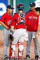 """July 28, 2009:  Starting Pitcher Junichi Tazawa of the Pawtucket Red Sox talks with catcher Dusty Brown, his interpreter, and pitching coach Rich Sauver watch before a game at Coca-Cola Field in Buffalo, NY.  Tazawa was signed out of Japan and making his """"AAA"""" debut with Pawtucket, the International League Triple-A affiliate of the Boston Red Sox.  Photo By Mike Janes/Four Seam Images"""