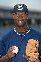 Lake County Captains pitcher Carlos Melo (46) poses for a photo before a game against the Dayton Dragons on June 8, 2014 at Classic Park in Eastlake, Ohio.  Lake County defeated Dayton 4-2.  (Mike Janes/Four Seam Images)