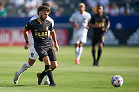 CARSON, CA - MAY 8: Diego Rossi #9 of LAFC passes off the ball during a game between Los Angeles FC and Los Angeles Galaxy at Dignity Health Sports Park on May 8, 2021 in Carson, California.