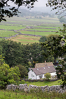 UK, England, Kettlewell, Yorkshire Dales.  Village House and Stone Walls Delineating Pastures in the Background.
