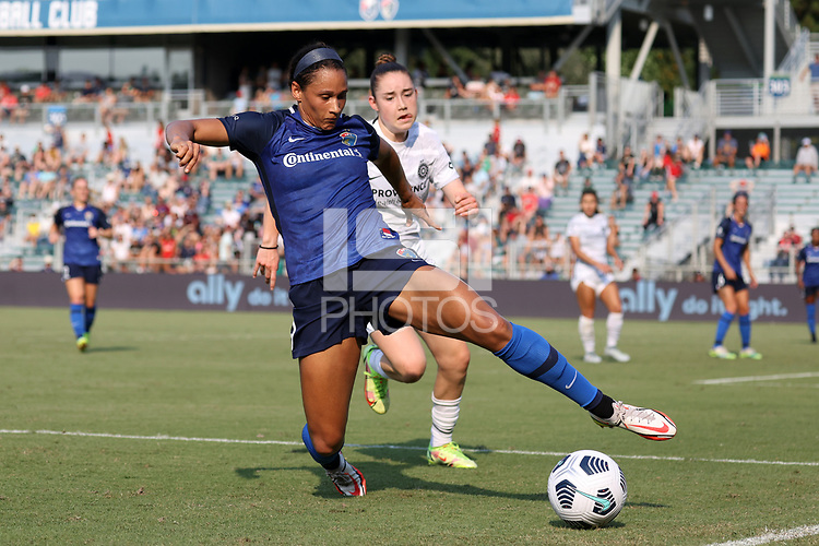 CARY, NC - SEPTEMBER 12: Lynn Williams #9 of the North Carolina Courage plays the ball away from Olivia Moultrie #42 of the Portland Thorns FC during a game between Portland Thorns FC and North Carolina Courage at Sahlen's Stadium at WakeMed Soccer Park on September 12, 2021 in Cary, North Carolina.