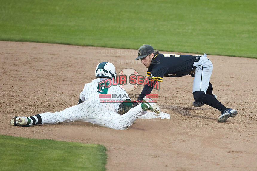 Craig Keuchel (9) of the Charlotte 49ers slides into second base avoiding the tag by Bailey Welch (3) of the Appalachian State Mountaineers at Atrium Health Ballpark on March 23, 2021 in Kannapolis, North Carolina. (Brian Westerholt/Four Seam Images)