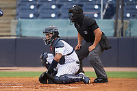 Tampa Tarpons catcher Carlos Narvaez (5) and umpire Rainiero Valero during a game against the Fort Myers Mighty Mussels on May 19, 2021 at George M. Steinbrenner Field in Tampa, Florida. (Mike Janes/Four Seam Images)