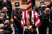 President Donald Trump's Chief of Staff John Kelly, left, watches as Former Sen. Alan Simpson, R-Wyo, right, touches the flag-draped casket of former President George H.W. Bush as it is carried out by a military honor guard during a State Funeral at the National Cathedral, Wednesday, Dec. 5, 2018, in Washington. <br /> Credit: Andrew Harnik / Pool via CNP