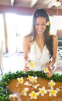 Young Hawaiian woman getting ready to make a plumeria lei