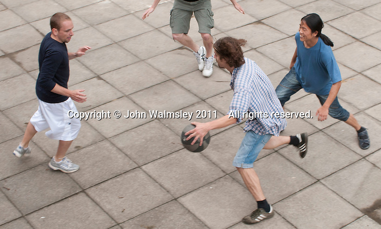 An impromptu game of basketball at the reunion for Summerhill School's 90th birthday celebrations.