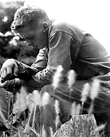 A young Marine finds a moment of quiet and solitude in which to offer up a prayer for the safety of himself and his comrades.  Minutes later, the 1st Marine Division launched an offensive against entrenched communist troops.  Ca. 1951. Cpl. Eugene Suarez.  (Marine Corps)<br /> Exact Date Shot Unknown<br /> NARA FILE #  127-N-A156900<br /> WAR & CONFLICT BOOK #:  1462