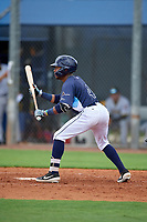 GCL Rays Christian Johnson (4) squares to bunt during a Gulf Coast League game against the GCL Pirates on August 7, 2019 at Charlotte Sports Park in Port Charlotte, Florida.  GCL Rays defeated the GCL Pirates 5-3 in the second game of a doubleheader.  (Mike Janes/Four Seam Images)