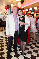 """NO REPRO FEE. 26/5/2011. NEW EDDIE ROCKET'S SHAKE SHOP. Peter and Jessica Fortune are pictured in the new Eddie Rocket's Shake Shop. The design seeks to recall the vintage milkshake bars from 1950's America and re-imagine them for the 21st century. The new look aims to appeal to both young and old with a quirky and bold colour scheme and a concept of make-your-own milkshakes, based on the tag line """"You make it...We shake it!"""". Eddie Rocket's City Diner in the Stillorgan Shopping Centre in south Dublin has re-opened after an exciting re-vamp and the addition of a Shake Shop. Ten new jobs have been created with the Diner's re-launch bringing the total working in Eddie Rocket's Stillorgan to 30. Picture James Horan/Collins Photos"""