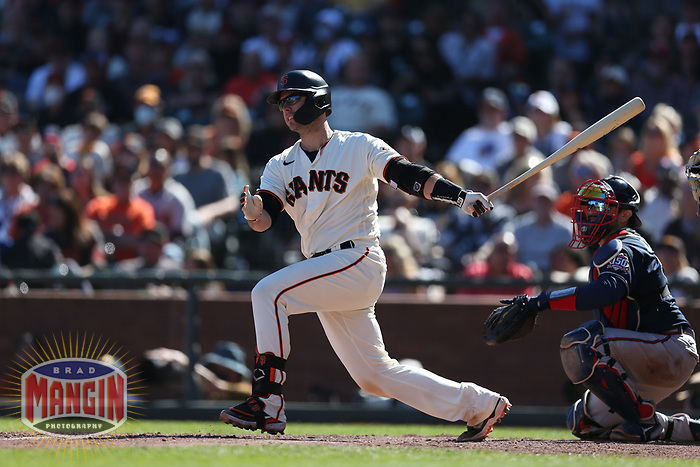 SAN FRANCISCO, CA - SEPTEMBER 19:  Buster Posey #28 of the San Francisco Giants bats against the Atlanta Braves during the game at Oracle Park on Sunday, September 19, 2021 in San Francisco, California. (Photo by Brad Mangin)