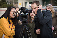UAA Journalism and Public Communication student Chase Burnett reviews footage while filming a story for an assignment in Professor Joy Mapaye's Television News Reporting course (JPC A344).