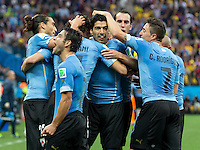 Luis Suarez of Uruguay celebrates scoring a goal with team mates after making it 1-0