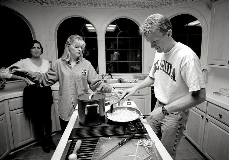 Image copyright John Angerson. <br /> STS-72 mission training.<br /> Space Shuttle pilot Brent W. Jett Jr. cooking at home with his wife Janet. Before joining the NASA Astronaut program he worked as a test pilot at the Carrier Suitability Department of the Strike Aircraft Test Directorate. He logged 5,000 flight hours in more than 30 different aircraft and has over 450 carrier landings.<br /> Johnson Space Center, Houston, Texas.